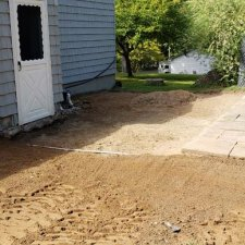 Ground prep work being done for addition of new sunroom