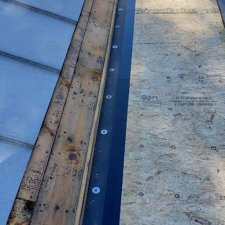New rubber roof tie-in to existing standing seam roof in progress