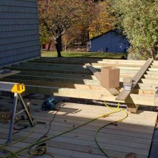 Pressure treated deck framework under construction for hot tub deck
