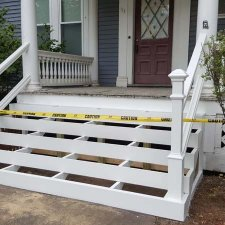Porch stair and railing replacement in progress on porch remodel project