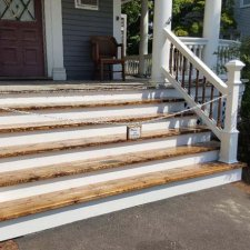 Stair and railing replacement compete on front porch stair replacement job