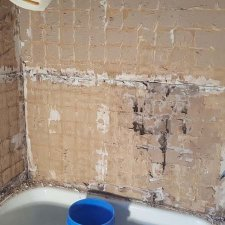 Existing tile removed in preparation for new bathtub shower surround