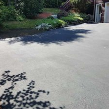 New driveway sealer installation complete