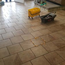 Floor tile installation in progress