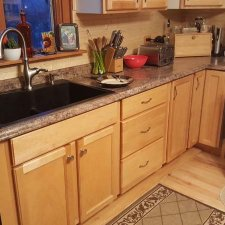 Countertop, sink and base cabinets installed
