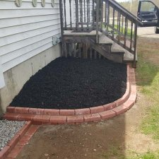 Planting bed covered in dark mulch for landscaping remodel