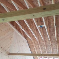 ceiling fan support and electrical box installed in porch ceiling