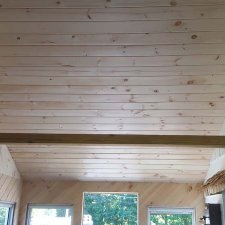 pine tongue and groove boards installed on ceiling of porch