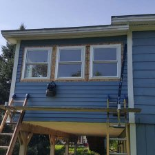 New windows being installed on porch remodel