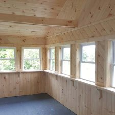 Interior view of custom carpentry woodwork on trim and window sills