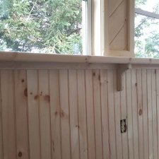 Custom trim and sill woodwork for new windows installed on porch